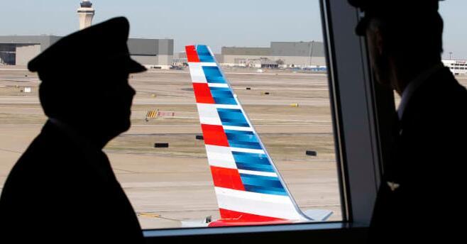 美国航空公司飞行员工会计划在机场进行纠察因为疲劳和过度安排的紧张局势升温
